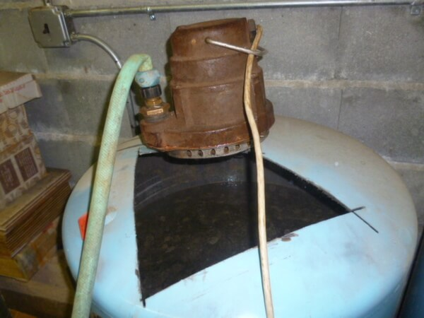 195_putting_in_submersible_pump_to_remove_water_from_tank